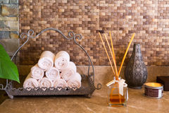 Concept of spa essentials. Towels, aroma, candle. Spa interior Stock Photo
