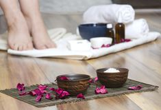 Concept of spa salon therapy. Preparing for pedicure treatments, relaxation mood royalty free stock photo