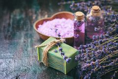 Concept spa therapy. Natural handmade soap, fresh lavender blossoms with Natural handmade lavender oil, sea salt. Selective focus stock photography