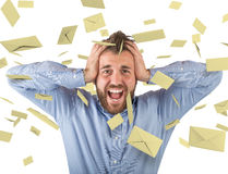 Concept of spam. With man and flying email Stock Photos