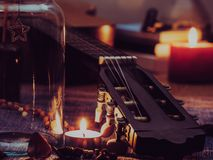 Concept of sparklers in Glass jar with some of the guitar. On blurred light candle burning  background Stock Photography