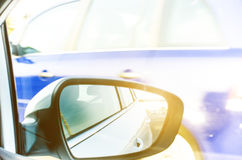 Concept of speed. Car driving on the road. Reflection in a car mirror.Rear view mirror reflection. Blurry background. Stock Photo
