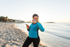 Concept of sport, fitness, healthy lifestyle and running - Motivated sporty woman doing thumbs up success gesture after Stock Image