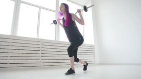 Concept of sport and fitness. Young woman barbell in the gym or home stock footage