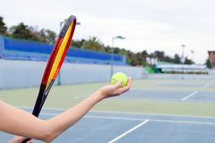 The concept of sport and outdoor activities. A game with a big tennis - a hand with a ball and a racket. stock images