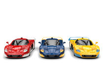 Concept sports cars in red, blue and yellow base paints with white yellow and blue decals Royalty Free Stock Photos