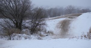 Concept of sports, healthy recreation. Quad Biking in the snow. ATV riding in the snow stock footage
