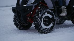 Concept of sports, healthy recreation. Quad Biking in the snow. Concept Sport. Concept of sports, healthy recreation. Quad Biking in the snow. ATV riding in the stock video
