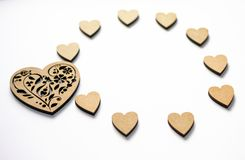 Concept of spring, love, feelings, lightness, tenderness. Happy Valentine`s day! Round frame of wooden hearts on white background royalty free stock photos