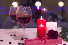 The concept of St. Valentine's Day with wine and candles Stock Photo