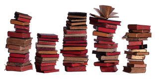 Concept of stacked old books with aged pages. On white stock photos