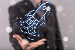 Concept of start up. Start up concept above the hand of a man in background Royalty Free Stock Photography