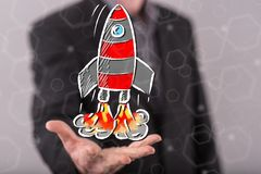 Concept of start up. Start up concept above the hand of a man in background Royalty Free Stock Photo