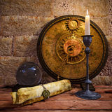 Concept still life with zodiac sighs and candle Stock Images