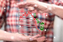 Concept of stock market crash. Stock market crash concept between hands of a woman in background stock photo