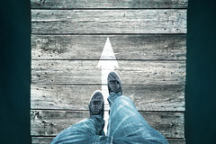 Concept straight arrow with man legs Royalty Free Stock Image
