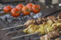 The concept of street food: grilled tomatoes and meat.  royalty free stock images