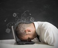 Stress concept. Concept of stress with businessman sleeping on a laptop Stock Photo