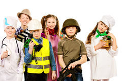 Concept student. A group of children dressed in costumes of different professions. Isolated over white Royalty Free Stock Photos