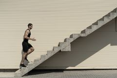 Concept of success and achieving your goal, man climbing stairs. royalty free stock photos