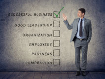 Concept success business. Businessman pointing at the main points of a successful business Stock Photos