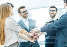 concept of success in business: friendly business team standing in a circle and joining his hands together Royalty Free Stock Photos