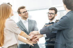 concept of success in business: friendly business team standing in a circle and joining his hands together Royalty Free Stock Photography