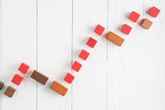 The concept of success. Business graph. Growth progress concept. Growing graph from wooden blocks. Bar graph royalty free stock image