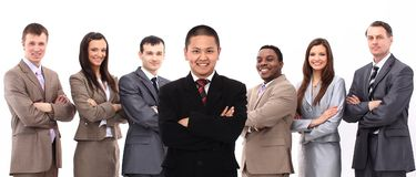 Businessman standing in front of his business team Stock Photos
