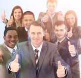 Happy business team holding thumbs up Stock Images