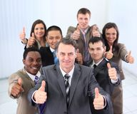Happy business team holding thumbs up Stock Photos