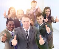Happy business team holding thumbs up Royalty Free Stock Photo
