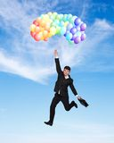 Concept of success. Businessman flying high concept of success Royalty Free Stock Photography
