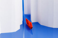Concept of success, moving forward. Origami paper boat on water as an icebreaker Stock Images