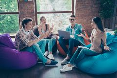 Concept of success and support. Youth diversity hipster guys and stock photography