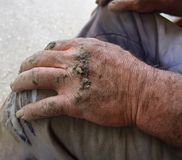 Strong dirty hands of a countryside rural area plumber. Concept of successful hard-working person who provides future for his chil. Concept of successful hard royalty free stock image
