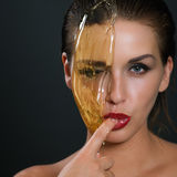 Concept sugaring epilation skin care with liquid sugar near face Royalty Free Stock Photo