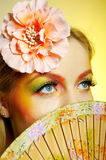 Concept summer fashion woman with creative make-up. Concept of summer fashion woman with creative eye make-up in yellow and green tones. copy-space royalty free stock images