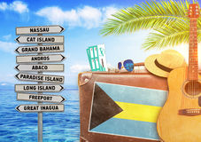 Concept of summer traveling with old suitcase and Bahamas Royalty Free Stock Images