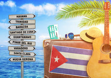 Concept of summer traveling with old suitcase and Cuba royalty free stock photo
