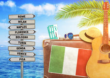 Concept of summer traveling with old suitcase and Italy town sign Royalty Free Stock Images