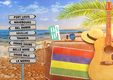 Concept of summer traveling with old suitcase and Mauritius town Royalty Free Stock Image