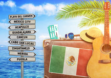 Concept of summer traveling with old suitcase and Mexico town sign. Close Stock Photos