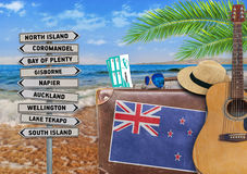 Concept of summer traveling with old suitcase and New Zealand stock images