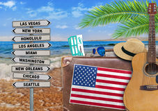 Concept of summer traveling with old suitcase and US town sign. Close Stock Image