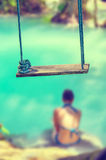 Concept of summer traveling with wooden swing and woman wearing Royalty Free Stock Images