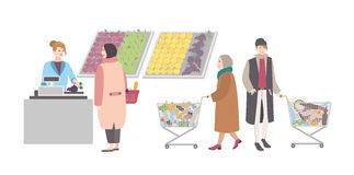 Concept for supermarket or shop. Different people with shopping cart weighed goods in vegetable department. Girl weighs Royalty Free Stock Photos