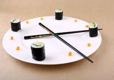 Concept of Sushi Time with caviar as clock Stock Images