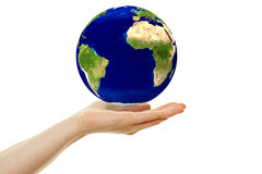 Concept for sustainability with hoovering earth. Globe over a hand Royalty Free Stock Images