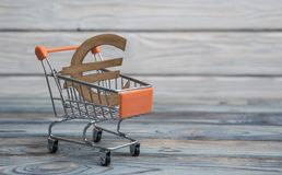 The concept of the symbol of the euro. In the shopping trolley.sale, buying currency Royalty Free Stock Photo